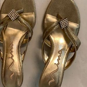 Gold sandals with rhinestones